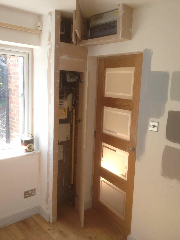 boxing in corner cupboard and fuse box cover